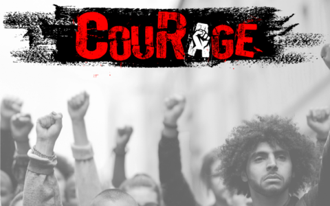 A group of protesters with their fists raised beneath the word CouRage