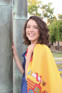 Girl smiling and holding the Spain Flag